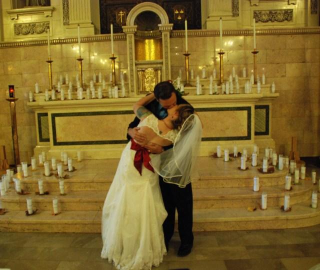 Aja Rossman Gray and Alfred Eaker wedding kiss