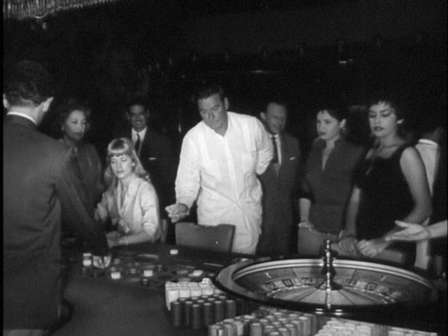 CUBAN STORY Errol Flynn gambling with Beverly Aadland