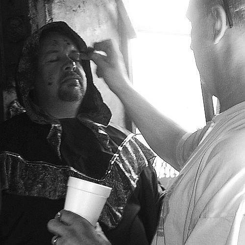 requiem for the relentless fahters. Steve making Chris up  for the killing of the priest.  © alfred eaker 2012