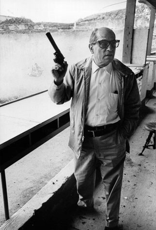 Luis Bunuel with gun